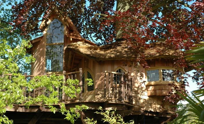 The Fairytale Castle treehouse, built and designed by Blue Forest, has a four metre solid oak Gothic arched window.