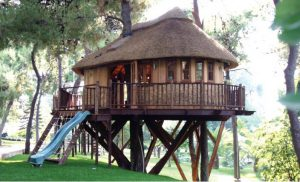 The High Tech Hideaway treehouse, built and designed by Blue Forest, combines natural materials with modern accessories.