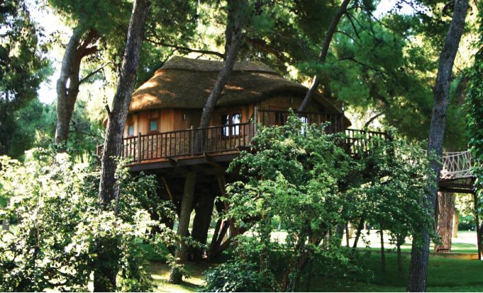 The High Tech Hideaway treehouse, built and designed by Blue Forest, fits snugly into the surrounding trees.