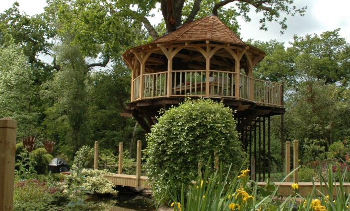 The Treetop Dining treehouse, built and designed by Blue Forest, is roofed with weathered cedar shingles.