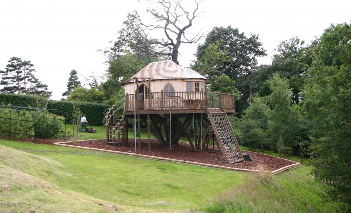 The Leafy Home treehouse, designed and built by Blue Forest, has a variety of adventure play items and is surrounded by a soft bark ground surfacing.