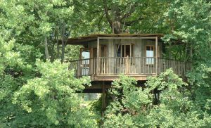 The Lakeside Treehouse, built and designed by Blue Forest, has a large veranda.