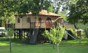 The Treehouse Office, built and designed by Blue Forest, includes a climbing net and slide.