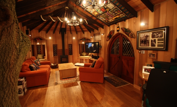 The Treehouse Office, built and designed by Blue Forest, has a rustic lounge area.