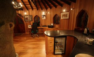 The Treehouse Office, built and designed by Blue Forest, has a kitchenette with a wine cooler.