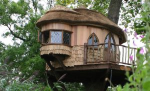 The exterior of Amerley Castle treehouse, built an designed by Blue Forest, features hand-split oak shingles