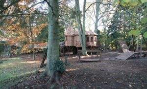 The Sleepy Hollow treehouse, built and designed by Blue Forest, has a variety of adventure play items.