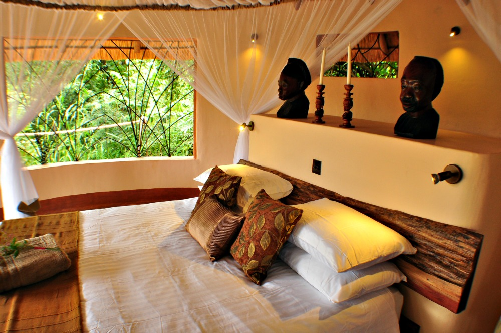 The bedroom of the Tongole Wilderness Lodge in Malawi, a treehouse designed by Blue Forest.