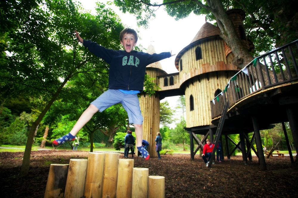 The Birr Castle treehouse, built and designed by Blue Forest, includes various adventure play items.