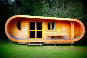 The curvy cabin, built and designed by Blue Forest, provides a comfortable alternative to camping.
