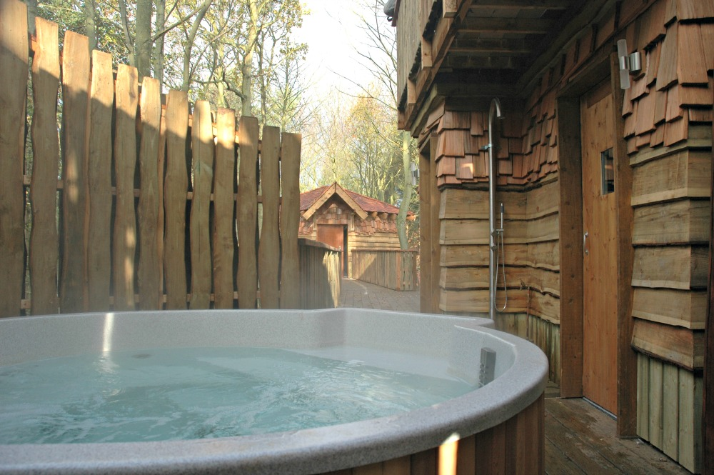 A hot tub at one of the Center Parcs treehouses, designed by Blue Forest.