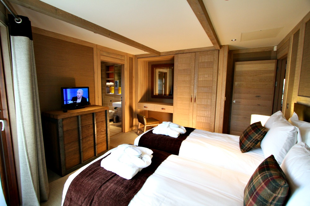 The bedroom of one of the Center Parcs treehouses, designed by Blue Forest.