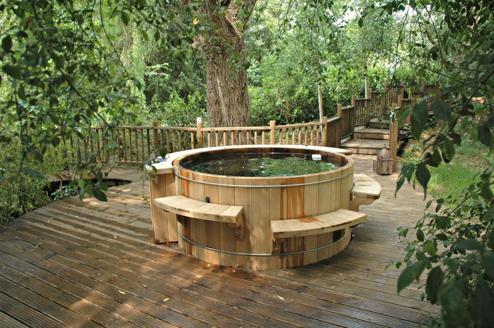 The Willow Nook treehouse, designed and built by Blue Forest, has a feature hot tub.