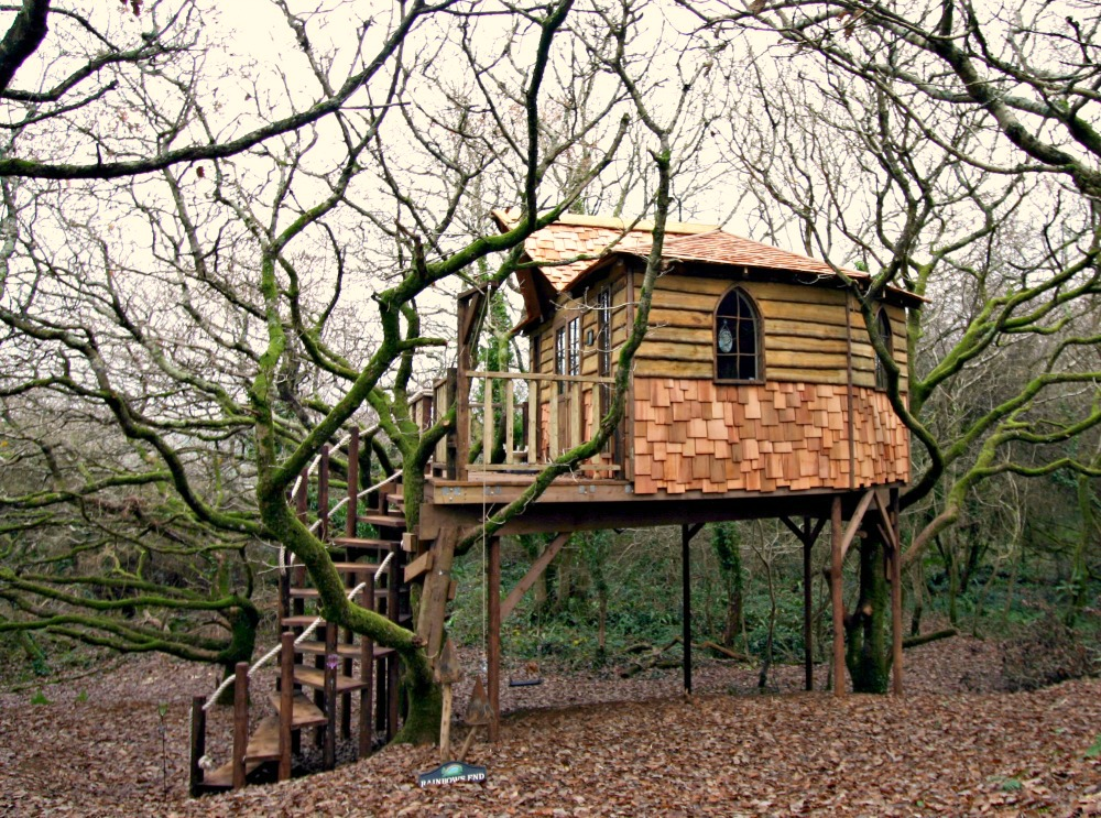 Waney edge timber cladding and randomly set cedar shingles give the Fairy treehouse, designed and built by Blue Forest, a rustic feel.