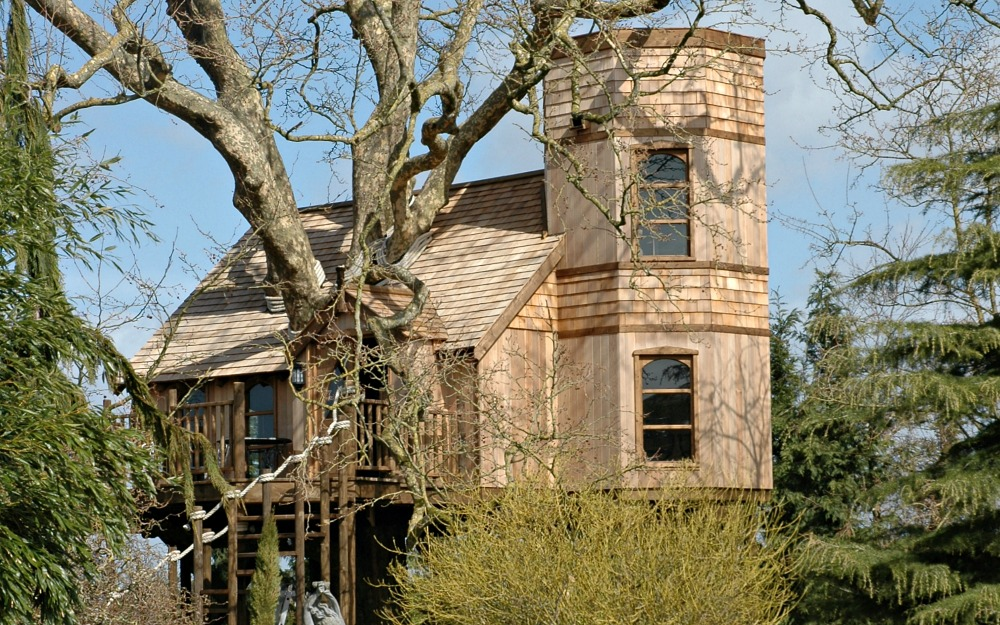 The treehouse castle, built and designed by Blue Forest, imitates the Tudor Gothic style.