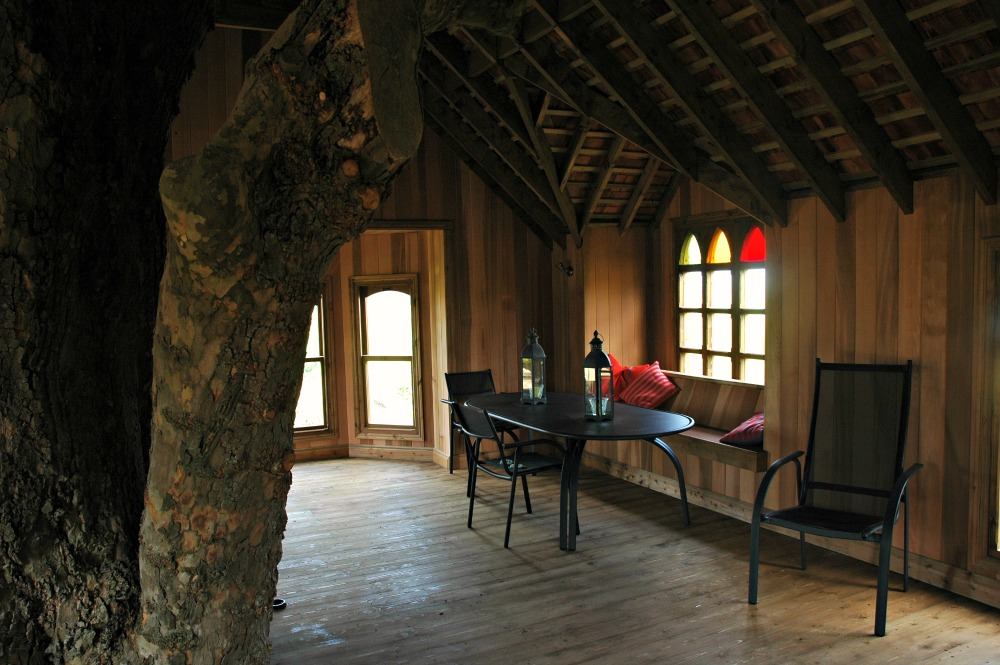 The interior of the treehouse castle, built and designed by Blue Forest, imitates the Tudor Gothic style.