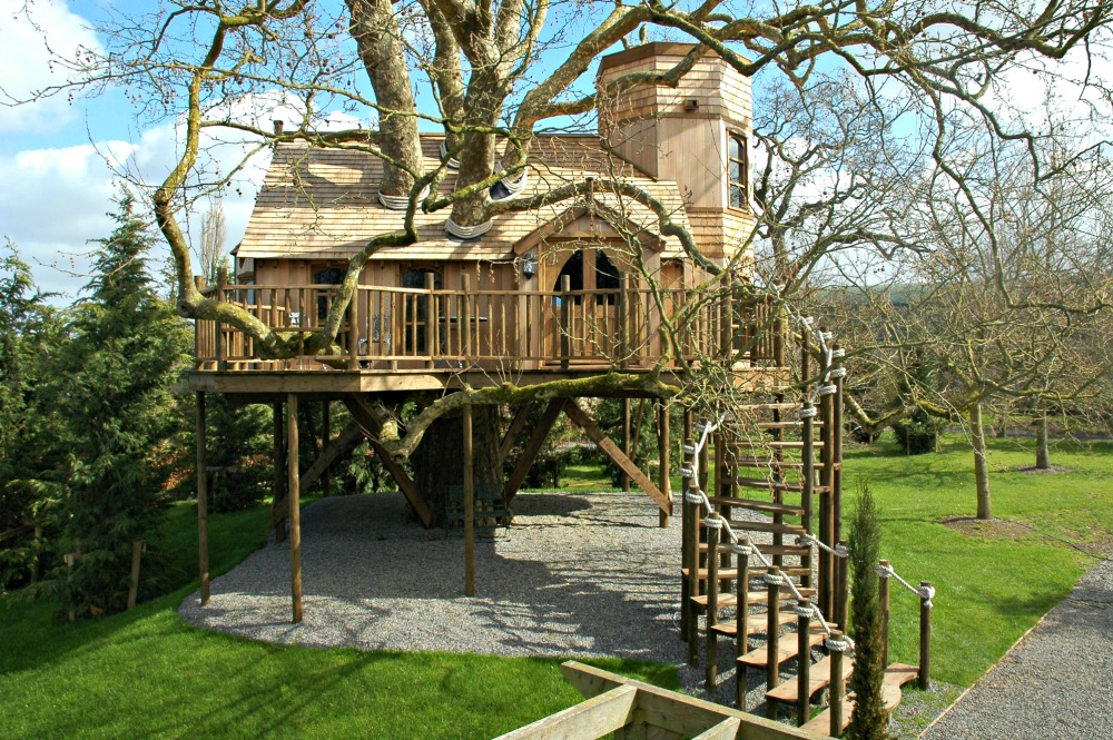The treehouse castle, built and designed by Blue Forest, incorporates the host tree.