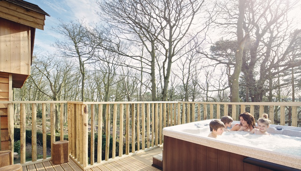 A hot tub on the deck of the Alton Towers Enchanted Village treehouse, designed and built by Blue Forest.