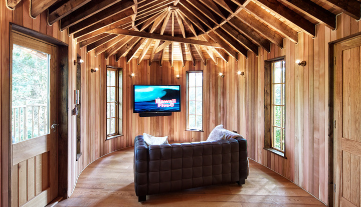 The Little Acorn treehouse, built and designed by Blue Forest, has a bespoke home cinema and surround sound system.