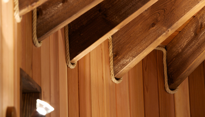 The Little Acorn treehouse, built and designed by Blue Forest, has ceiling slats finished with polyhemp rope trim.