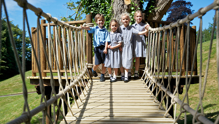 Hazelwood School Treehouse, built and designed by Blue Forest, is linked to a further deck by rope bridge.