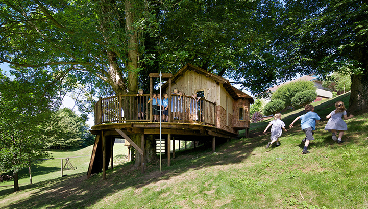 Hazelwood School Treehouse, built and designed by Blue Forest, has exciting play items including a  fireman's pole.