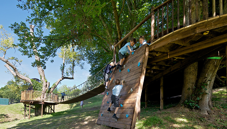 Hazelwood School Treehouse, built and designed by Blue Forest, has exciting play items including a climbing wall and fireman's pole.