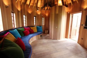 The Enchanted Hideouts, designed and built by Blue Forest, have a built in sofa with bespoke upholstery.