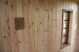 The walls of the Lookout Treehouse, designed and built by Blue Forest, are lined with Pine tongue and groove lining.
