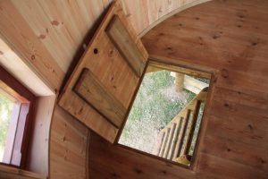 A trapdoor leading to the Lookout Treehouse, designed and built by Blue Forest.