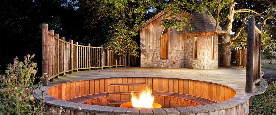 The Nook Treehouse features a private space enclosed by handrails leading from the treehouse to the  outside seating area. The sunken firepit is great for long evenings outside and when the fire has died down, a bit of stargazing.